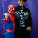 Happy Teen posing with spiderman